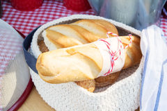 Bread bakery product. Background of bread and other bakery product. Composition of bread on a checkered napkin drapery background. Bread from wholemeal flour Stock Image