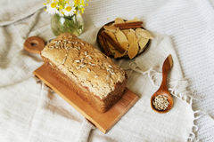 Bread bakery product. Background of bread and other bakery product. Composition of bread on a white drapery background. bread from wholemeal flour Stock Photos
