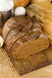 Bread and bakery products on wood Royalty Free Stock Images