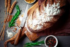 Bread baking in the composition. On the table with items for the kitchen Royalty Free Stock Image