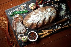 Bread baking in the composition. On the table with items for the kitchen Royalty Free Stock Photos