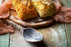 Bread baking in the composition. On the table with items for the kitchen Stock Images