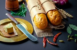 Bread baking in the composition. On the table with items for the kitchen Royalty Free Stock Photography