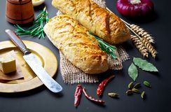 Bread baking in the composition. On the table with items for the kitchen Stock Photos