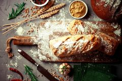 Bread baking in the composition. On the table with items for the kitchen Stock Photo