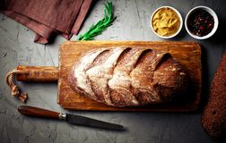 Bread baking in the composition. On the table with items for the kitchen Stock Image