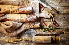 Bread baking in the composition. On the table with items for the kitchen Royalty Free Stock Photo