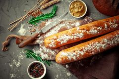 Bread baking in the composition. On the table with items for the kitchen Royalty Free Stock Images