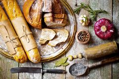 Bread baking in the composition. On the table with items for the kitchen Stock Photography