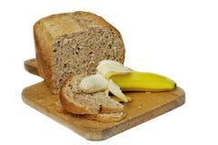 Bread & Banana. Granary Bread with a banana, ready to make sandwiches Royalty Free Stock Photography