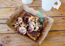 Bread with banana and chocolate sauce Royalty Free Stock Photos