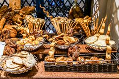 Bread bar station buffet catering, close-up Assortment of fresh pastry on table Pastry buffet set for breakfast in Egypt royalty free stock photography