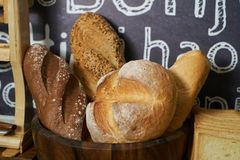 Bread bar station in buffet catering, close-up. Assortment of fr stock image
