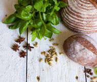 Bread and basil on the table Stock Photo