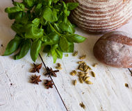 Bread and basil on the table Stock Photography