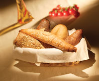 Bread Basket. Various fresh baked bread on a basket royalty free stock images