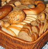 Bread in a basket. Some different kinds of bread as a close up image served in a wicker basket Royalty Free Stock Image