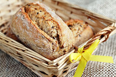 Bread in basket. Close up of whole grain rolls placed in wooden bread basket Stock Photography
