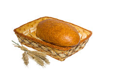 Bread in a basket with ears of wheat Royalty Free Stock Photos
