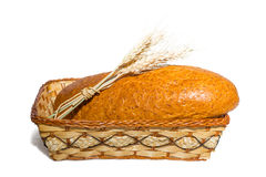 Bread in a basket with ears of wheat Royalty Free Stock Photo