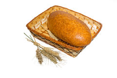 Bread in a basket with ears of wheat Royalty Free Stock Images
