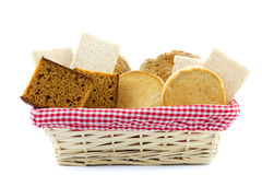 Bread basket filled with slices of bread, crackers, ontbijtkoek Royalty Free Stock Images
