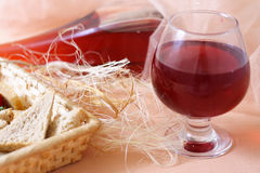 Bread basket and glass of wine.  Stock Image
