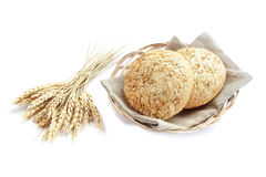 Bread in basket, isolated. Bread in basket and grains, on white background Stock Photography