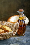 Bread in a basket and an olive oil Stock Images