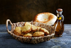 Bread in a basket and an olive oil Royalty Free Stock Photography