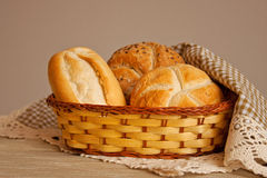 Bread in a basket of raffia Stock Images