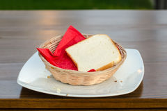 Bread in basket. Bread in wicker baskets and square plate on table Stock Photography