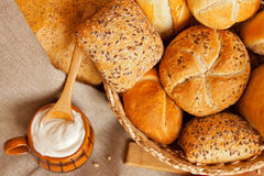 Bread in basket and yogurt Stock Photos