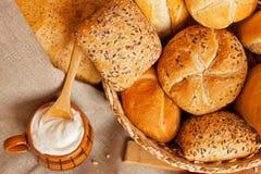 Bread in basket and yogurt stock photos
