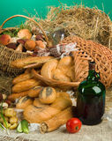 Bread And Baskets. Bread and wine on canvas tablecloth stock photos