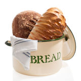 Bread Bin with Loaves. Bread bin with two rustic loaves on white background stock images