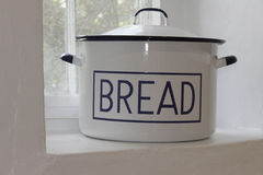 Bread bin. White traditional bread bin on whitewashed larder shelf Stock Photography