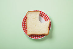 Bread with bite. On plate Royalty Free Stock Photo