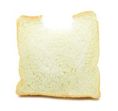 Bread bite. Bread with rectangular bite Photos white background stock photos