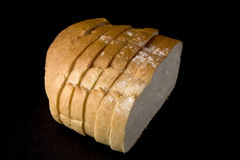Bread on a black background. Royalty Free Stock Photos