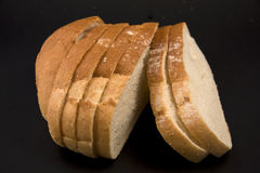 Bread on a black background. Sample a piece of sliced bread on a black background Stock Image