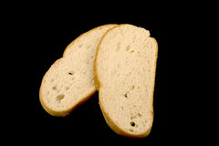 Bread on a black background. Stock Photo