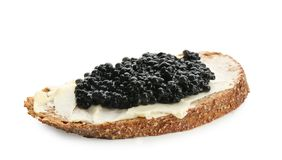 Bread with black caviar and butter Stock Image