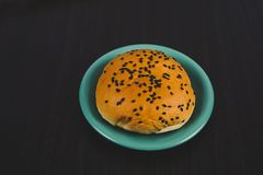 Bread with black sesame seeds in dish ware. On background stock photos