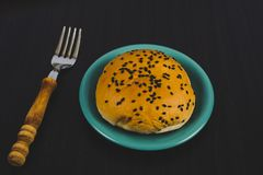 Bread with black sesame seeds in dish ware on background. Bread with black sesame seeds in dish ware on royalty free stock images