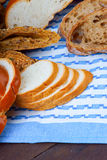 Bread on a blue tablecloth Stock Photos