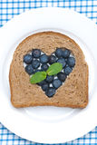 Bread with blueberries on the plate Stock Image