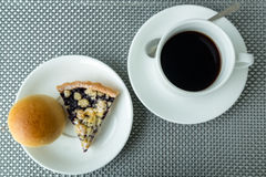 Bread with blueberry cheese pie with black coffee on table Royalty Free Stock Photography