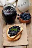 Bread with blueberry jam Stock Photos