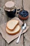Bread and blueberry jam in glass jar Royalty Free Stock Photography